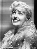 Jeanette MacDonald in Classic Portrait in White Silk Ruffled Sleeve Shoulder Dress and Necklace wit Photo by  Movie Star News