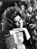 Irina Demick Leaning on Gift with Christmas Tree Photo by  Movie Star News