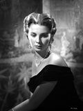 Jean Simmons Seated in Black Velvet Off-Shoulder Dress and Necklace with Dangling Earrings Photo by  Movie Star News