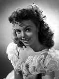Jean Porter Portrait in White Ruffled Off Shoulder Dress Photo by  Movie Star News
