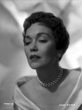 Jane Wyman Portrait in White Long Sleeve Shoulder Dress and Pearl Necklace with Pearl Earrings Photo by  Movie Star News