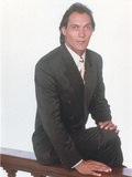 Jimmy Smits sitting Pose in Tuxedo Portrait Photo by  Movie Star News