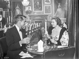 Indiscreet Lady in Printed Dress Talking to a Man in Suit Photo by  Movie Star News
