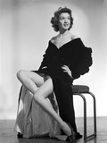 Jane Withers Seated on a Chair in Black V-Neck Ruffled Sleeve Dress with Sheer Petticoat Photo by  Movie Star News