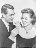 Indiscreet Man in Black Suit and Woman with Necklace Photo by  Movie Star News