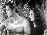 Johnny Weissmuller Being Looked Over by a Woman in a Classic Movie Scene Photo by  Movie Star News