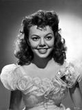 Jean Porter Portrait smiling in Ruffled Short Sleeve Silk Dress Photo by  Movie Star News