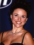 Julia Louis Dreyfus smiling and wearing a Spaghetti-Strap Dress in a Close Up Portrait Photo by  Movie Star News
