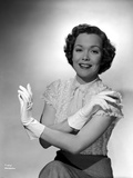 Jane Wyman Portrait in White Short Sleeve Silk Dress and Linen Tweed Skirt with Arms Crossed with G Photo by  Movie Star News