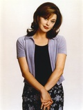Jane Leeves Posed in Black Short Sleeve Coat and Black Dress with Floral Black Skirt Photo by  Movie Star News