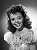 Jean Porter Portrait in Ruffled Sheer Sleeve Off Shoulder Dress Photo by  Movie Star News