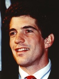 John Kennedy wearing a Black Suit in a Close Up Portrait Photo by  Movie Star News