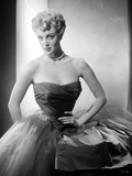 Jan Sterling Portrait in Black Velvet Dress with Sheer Silk Skirt while Hands on the Waist Photo by  Movie Star News