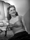 Joan Leslie on a Ruffled Top sitting on a Floor and smiling Photo by  Movie Star News
