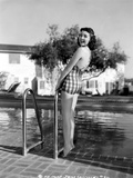 Jane Withers Posed in Gingham One Piece Swimsuit and Leaning Back while Hands Holding on the Metal  Photo by  Movie Star News