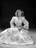 Joan Blondell on Printed Dress and sitting Photo by  Movie Star News