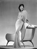 Jean Parker Posed in White Broad Sleeve Silk Dress and Fishtail Skirt with Left Hand on the Top Rai Photo by  Movie Star News
