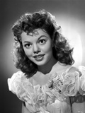 Jean Porter Portrait in White Sheer Silk Lace Top Ruffled Dress Photo by  Movie Star News