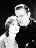 John Barrymore hugging a Woman in a Close Up Portrait Photo by  Movie Star News