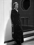 Irene Dunne on Black Long Dress Leaning on Wall Photo by  Movie Star News