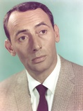 Joey Bishop wearing a Brown Suit in a Close-up Portrait Photo by  Movie Star News