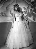 Jean Arthur Posed in White Strapless Silk Dress with Pleated Sheer Skirt with Head Turn to the Righ Photo by  Movie Star News