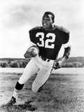 Jim Brown Playing in Football Attire With Football Ball Photo by  Movie Star News