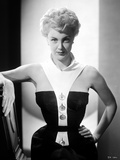 Jan Sterling Portrait in White Collar Neck Strap Black Velvet Shoulder Dress with Left Hand on the  Photo by  Movie Star News