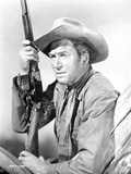 James Stewart Posed in Leather Jacket and Neckerchieft with Cowboy Hat while Holding a Sawed-Off Sh Photo by  Movie Star News