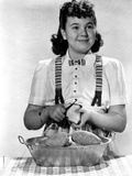 Jane Withers Posed in White Short Sleeve Bodice and Jumper Skirt with Hands Peeling a Potato Photo by  Movie Star News