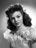 Jean Porter Portrait in Ruffled Shoulder Strap Dress Photo by  Movie Star News
