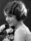 Janet Gaynor Holding a Flower Side view Pose Photo by  Movie Star News