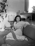 Martha Raye on a Dress sitting on a Couch Photo by  Movie Star News