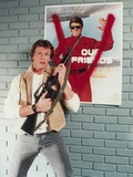 Marc Singer Posed in Leather Vest with Rifle Portrait Photo by  Movie Star News