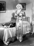 Marion Davies standing in Glossy Robe with a Smile Photo by  Movie Star News