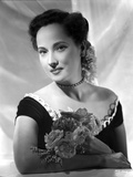 Merle Oberon on an Off Shoulder Dress with Flower Photo by  Movie Star News