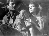 Most Dangerous Woman Holding Her Man's Shoulder in Black and White Photo by  Movie Star News