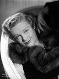 Madeleine Carroll smiling in Black Fur Coat Portrait Photo by  Movie Star News