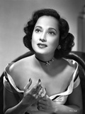 Merle Oberon on an Off Shoulder Top sitting Portrait Photo by  Movie Star News