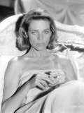 Lauren Bacall Lying on Bed in Black and White Photo by  Movie Star News