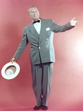 Maurice Chevalier Posed in Red Background Photo by  Movie Star News