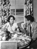 Merle Oberon sitting and smiling while Talking to a Man Photo by  Movie Star News