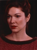 Laura Harring Close Up Portrait in Red Sweater with Earrings Photo by  Movie Star News