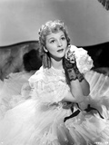 Mary Martin on a Ruffled Gown sitting on a Bed Photo by  Movie Star News