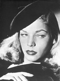 Lauren Bacall posed in Black Dress with Cap in Black and White Portrait Photo by  Movie Star News