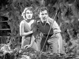 Most Dangerous Game Woman Holding Her Man's Shoulder and Hiding in The Cave in Black and White Photo by  Movie Star News