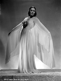 Jane Wyman Posed in White V-Neck Gathered Silk Bodice and Pleated Silk Skirt with Long Sheer Silk M Photo by  Movie Star News