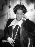 Merle Oberon sitting in Black Coat in Black and White Photo by  Movie Star News