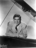 Johnnie Ray Leaning on Piano Photo by  Movie Star News
