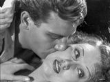 Most Dangerous Man Kisses his Girlfriend Cheeks in Black and White Photo by  Movie Star News